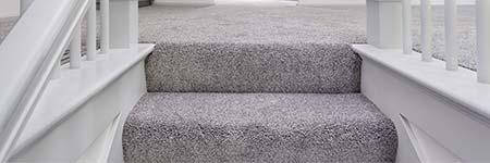 overzettreden trap tapijt
